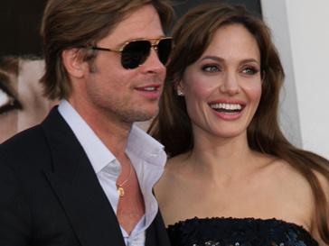 Анджелина Джоли с Брэдом Питтом на премьере фильма «Солт»