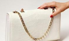 Виктория Бекхэм стала дизайнером рождественской сумки