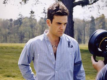 Робби Уильямс (Robbie Williams) поедет вместе с Take That на гастроли