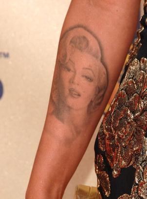 Татуировка Меган Фокс с изображением кумира.
