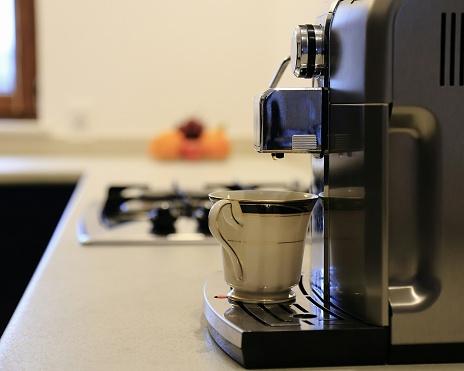 как почистить кофемашину от накипи лимонной кислотой