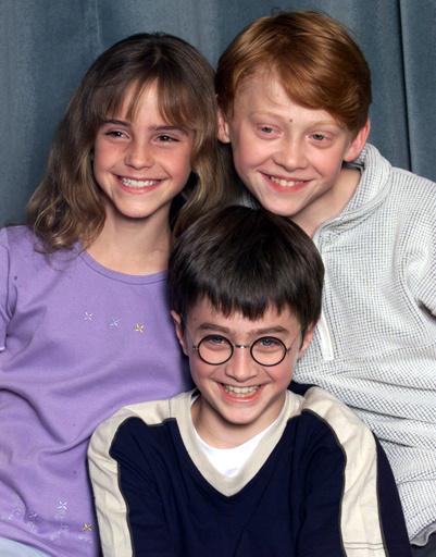 Эмма Уотсон (Emma Watson) в окружении коллег по саге о Гарри Поттере