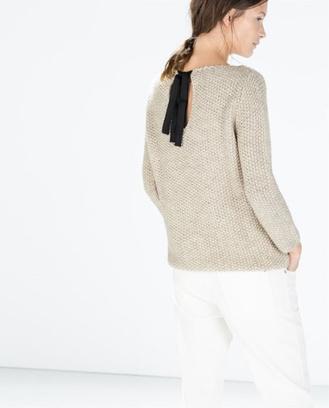свитера с бантами на спине