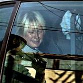Пэрис в полицейской машине