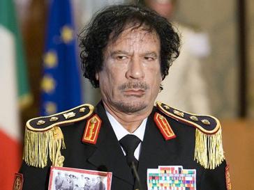 Муаммар Каддафи (Muammar Kaddafi) всеми способами пытается остаться у власти