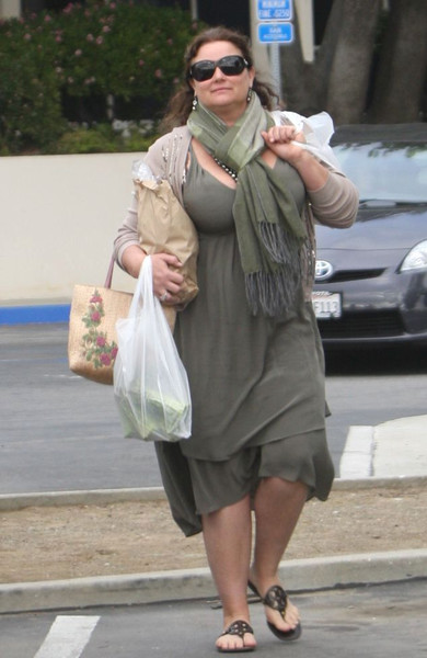 Фото №12 - Девушка Бонда весом в 100 кг: бьюти-трансформация жены Пирса Броснана