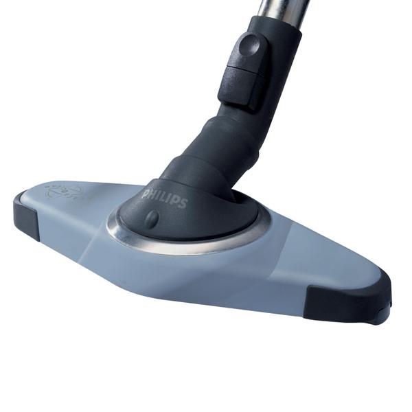 Поворотная щетка (Philips) поможет «разобраться» с пылью в стесненном пространстве комнаты, заставленной мебелью.