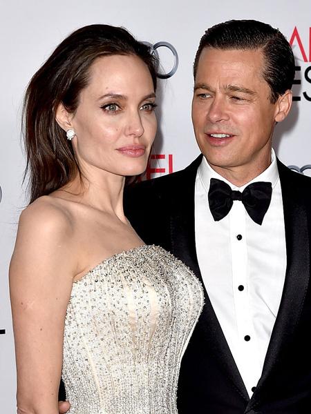 Фото №1 - Трудности развода: знакомые Джоли поддержали Питта