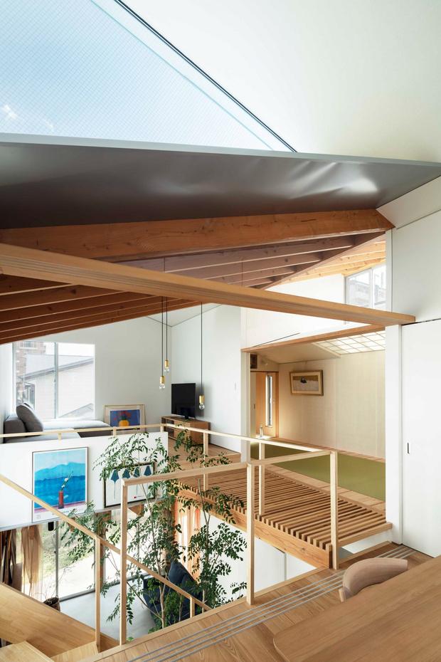 Фото №6 - Современный дом с атриумом в Японии