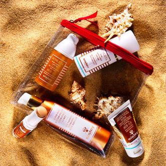 Средства из «солнечной» линии Sisley помогают получить красивый загар и улучшить качество кожи. По часовой стрелке: тонирующий водостойкий стик SPF 30 для защиты чувствительных зон лица, увлажняющий крем для тела с эффектом автозагара, антивозрастной крем для лица, шеи и декольте SPF 15 Sunleÿa, антивозрастной крем после загара Sunleÿa, бесцветный защитный крем для лица SPF 30 Grand Ecran Solaire Visage. Все – Sisley.