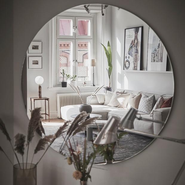 Фото №6 - Гостиная в скандинавском стиле: советы по декору и оформлению
